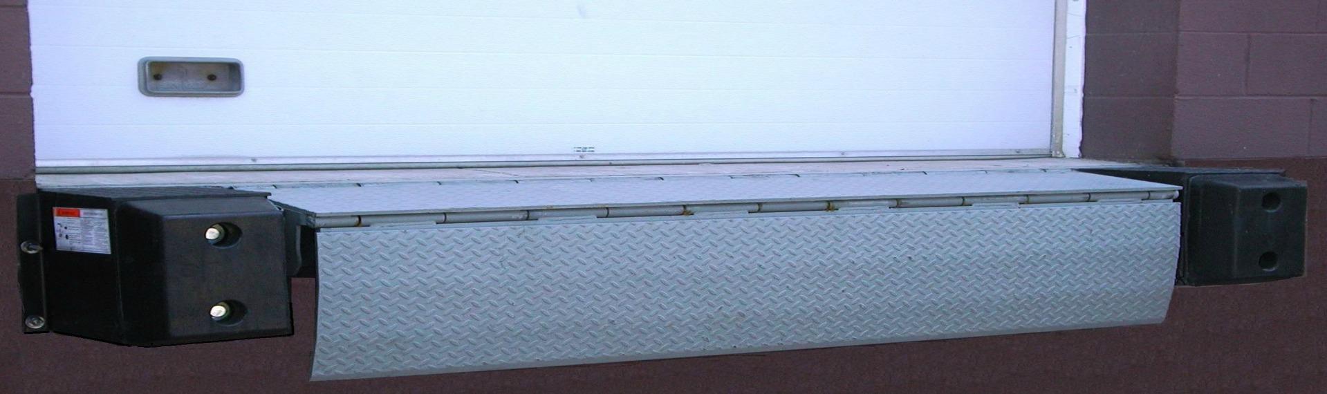 YARD-RAMP-SITE mechanical edge of dock leveler showing truck at dock loading
